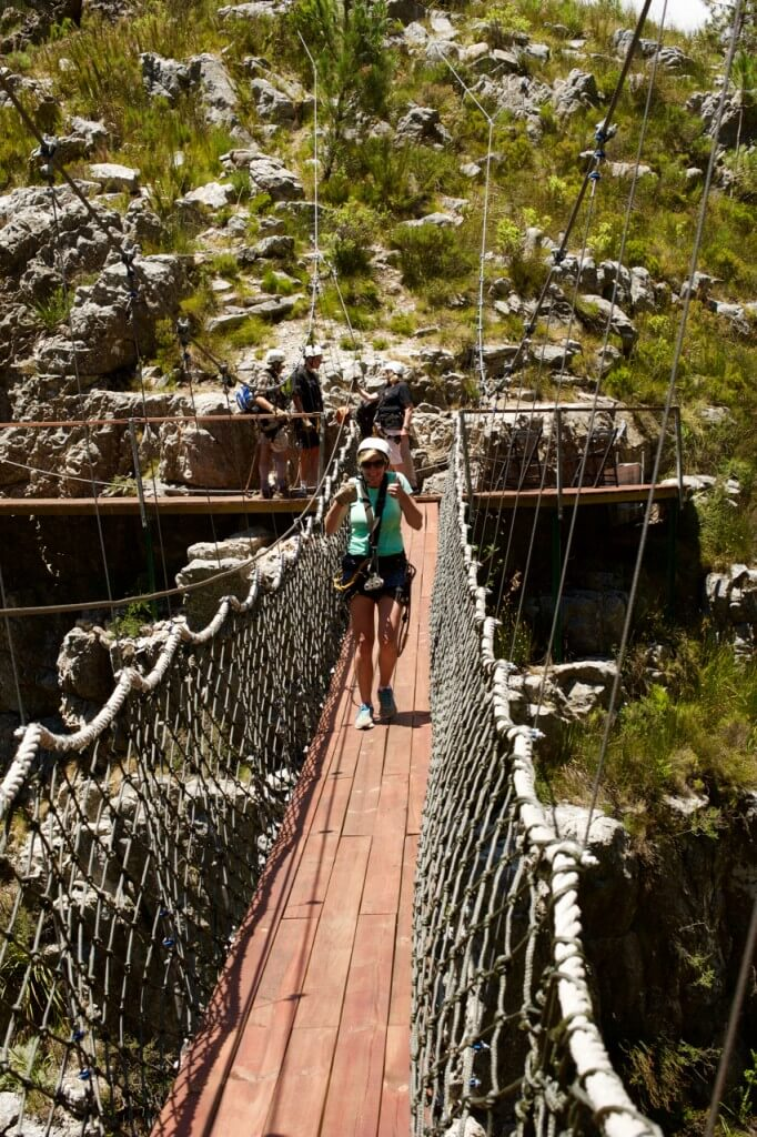 By this point, Linda is not the least bit daunted while crossing this rickety, swaying suspension bridge hundreds of metres above a chasm. (Francis Moran photo.)